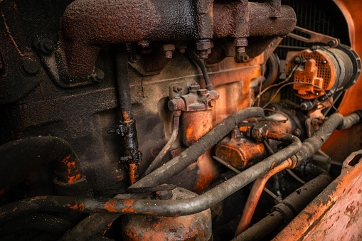 Oily engine of an old russian made tractor