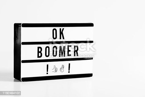 Ok boomer message in light box. Lightbox on the white background.