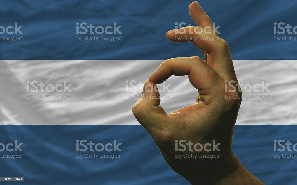 ok gesture in front of el salvador national flag royalty-free stock photo