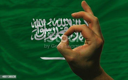 istock ok gesture in front of saudi arabia national flag 465138528