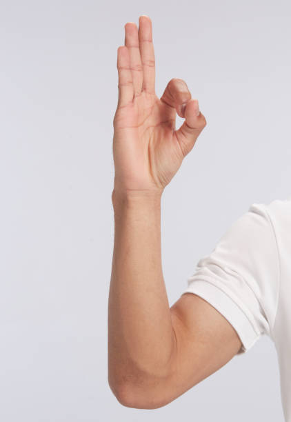 ok hand sign on white background ok sign on white background approbation stock pictures, royalty-free photos & images