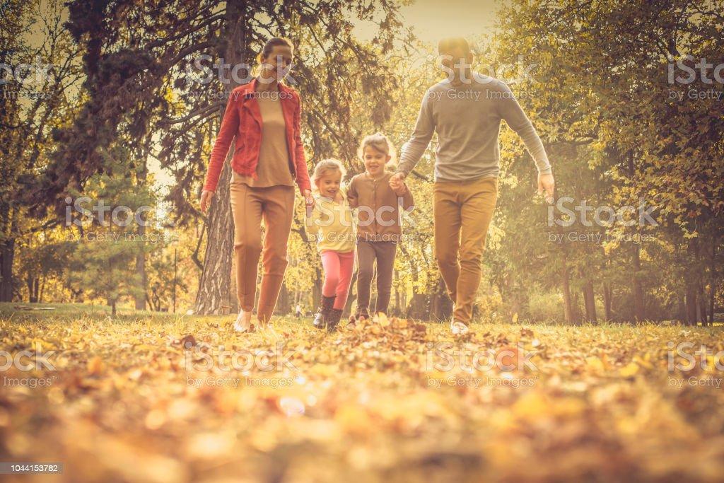 Ok, who running faster? Family reunion. Autumn season. stock photo