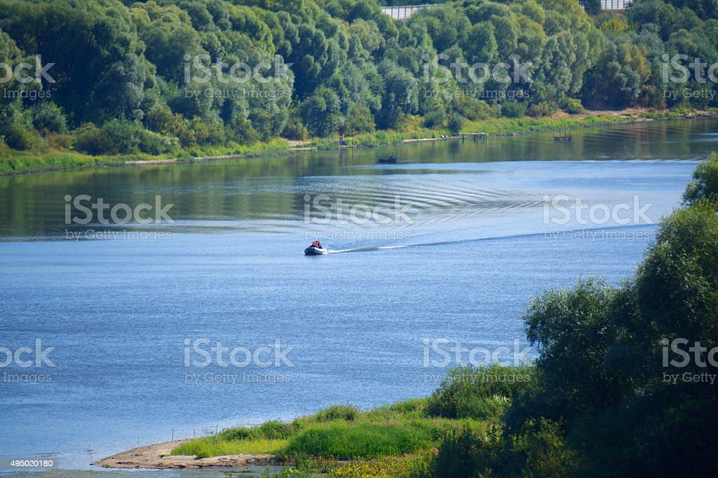 Oka river with a small boat stock photo