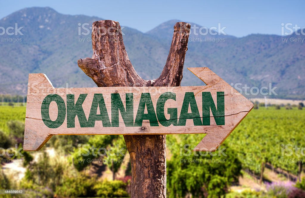 Okanagan wooden sign with winery background stock photo