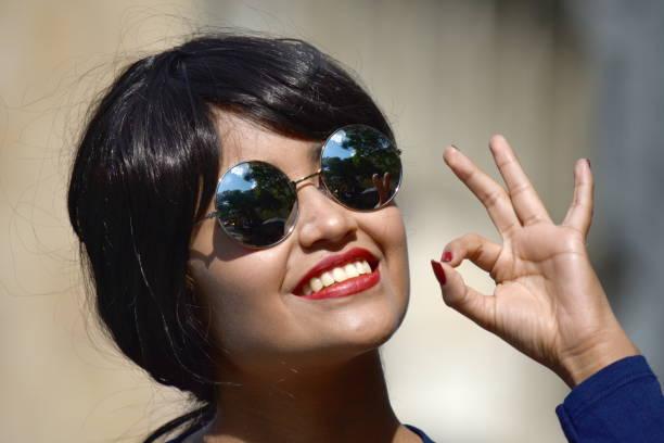 Okay Minority Female Woman Wearing Sunglasses stock photo