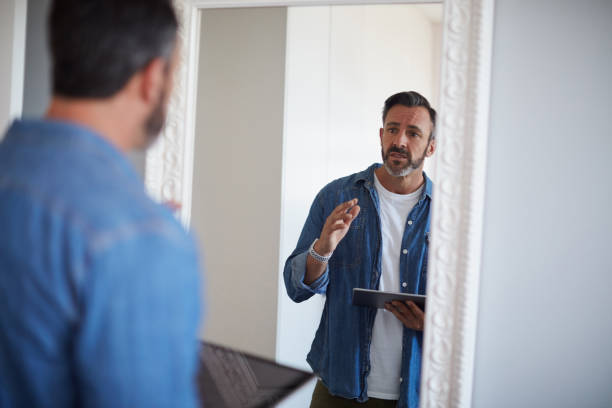 Okay you gotta do better than this Cropped shot of an attractive mature man having a rehearsal in the mirror while holding a digital tablet practicing stock pictures, royalty-free photos & images