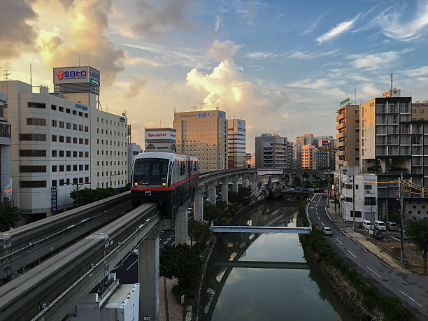 Okinawa Monorail (Yui-Rail) in the evening at Asahibashi Station Okinawa, Japan - July 25, 2016: Okinawa Monorail (Yui-Rail) is an only rail transport in Naha City, Okinawa, Japan. It's approaching Asahibashi station in the evening. naha stock pictures, royalty-free photos & images