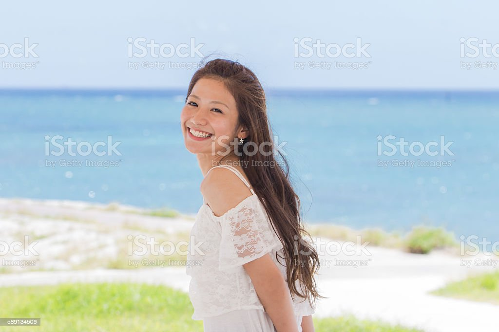 Okinawa sea and young women stock photo