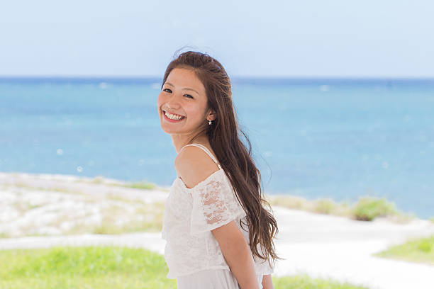 Okinawa sea and young women ストックフォト