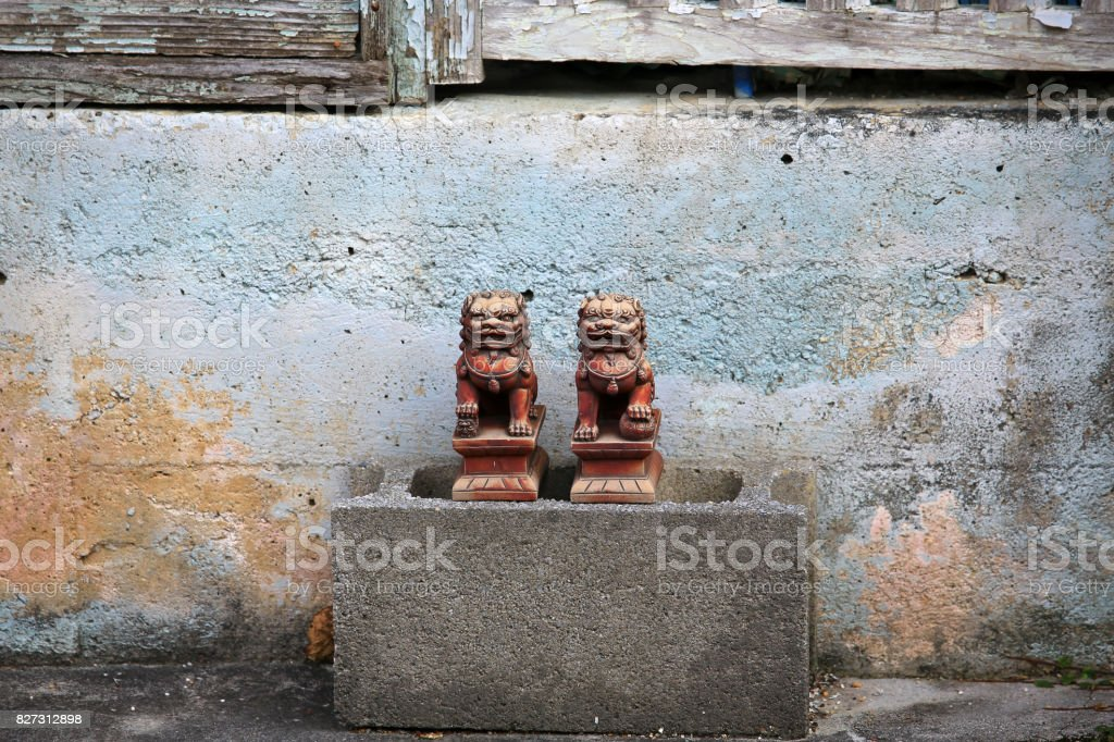 okinawa street view with the traditional lion rock statue stock photo