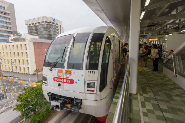 Okinawa Urban Monorail approaching train station in Okinawa, Japan. stock photo