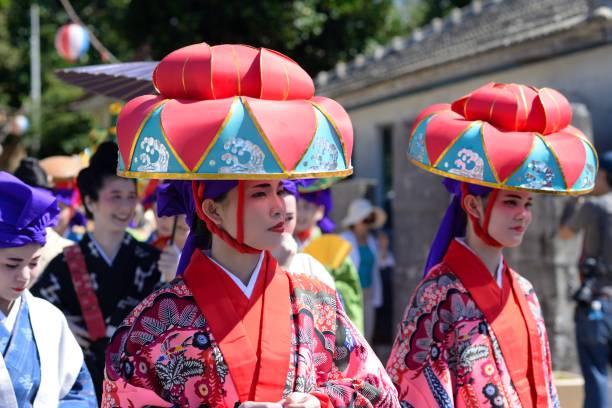 Okinawan matsuri Okinawa, Japan - September 23, 2015: People participating at a traditional celebration at Kouri Island. naha okinawa stock pictures, royalty-free photos & images