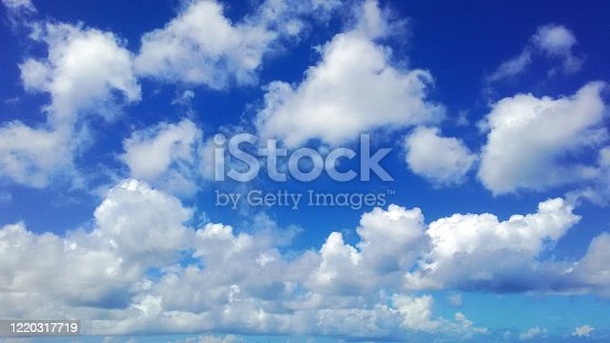 Okinawa`s summer blue sky with white clouds. Bright daylight outdoor scene.