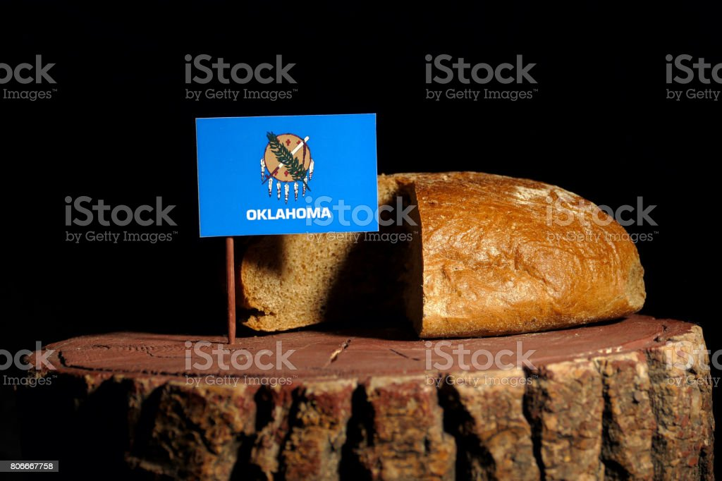 Oklahoma flag on a stump with bread isolated stock photo