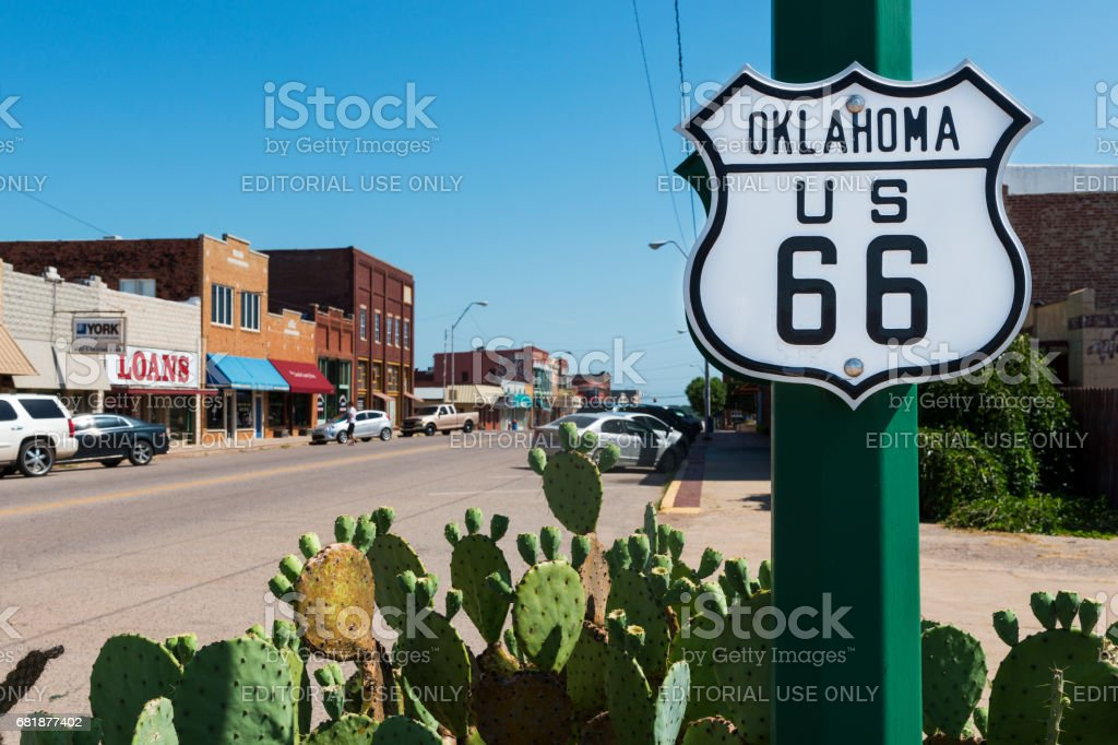 Oklahoma Route 66 Sign along the historic Route 66 in the State of Oklahoma, USA. US Route 66, Oklahoma - July 7, 2014: Oklahoma Route 66 Sign along the historic Route 66 in the State of Oklahoma, USA. American Culture Stock Photo