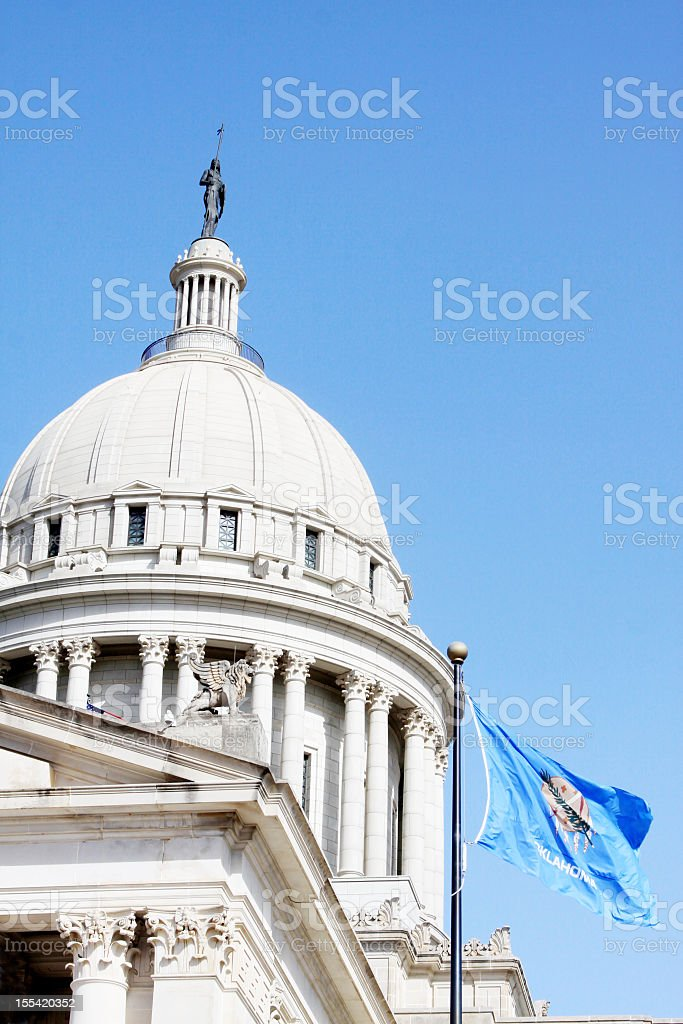 Oklahoma State Capitol Building with Flag royalty-free stock photo