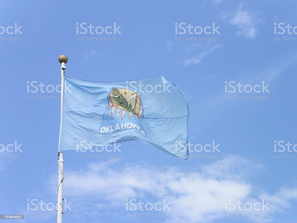 Oklahoma State Flag with Blue Sky stock photo