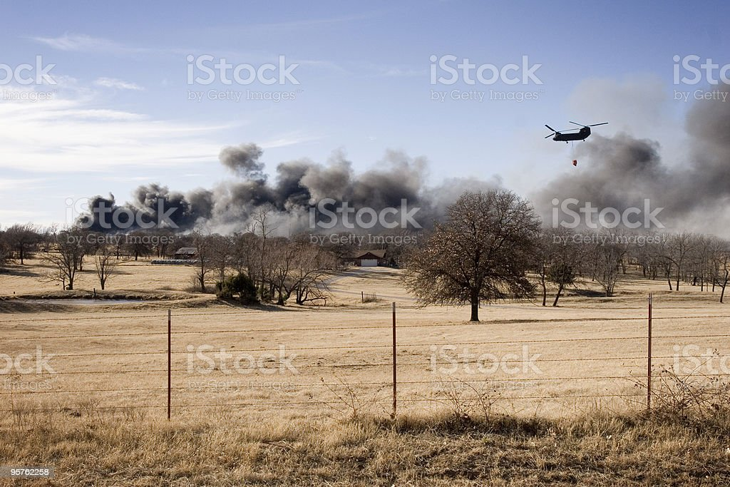 Oklahoma Wild Fire with Smoke and Firefighter Helicopter royalty-free stock photo