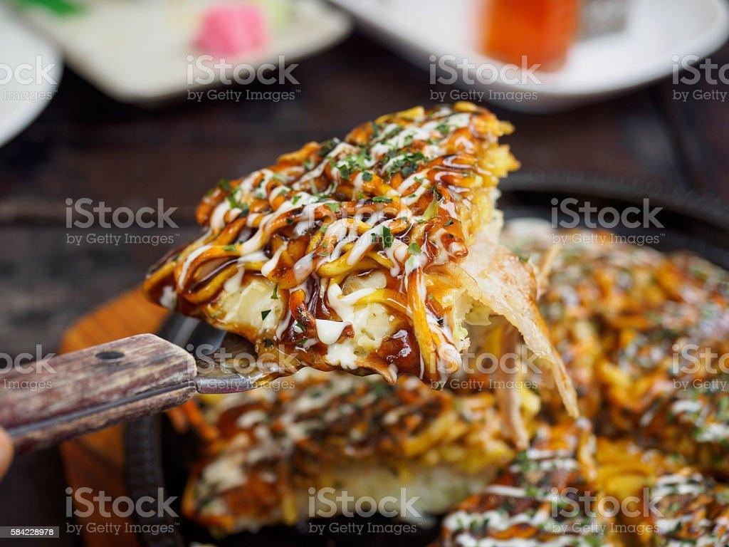 Okonomiyaki - Japanese hot plate pizza stock photo