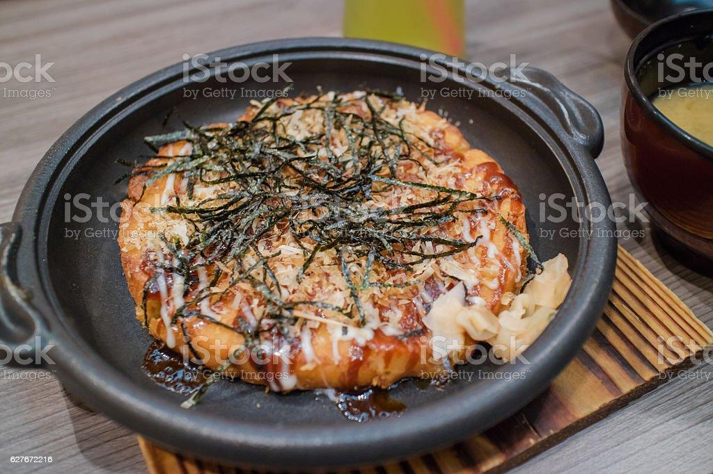 Okonomiyaki Japanese Traditional Pizza on hot plate stock photo