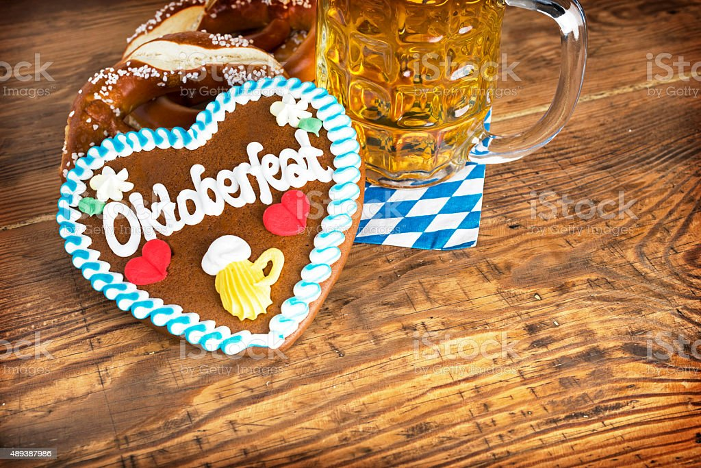 Oktoberfest Background – Gingerbread Heart with Beer and Pretzel stock photo