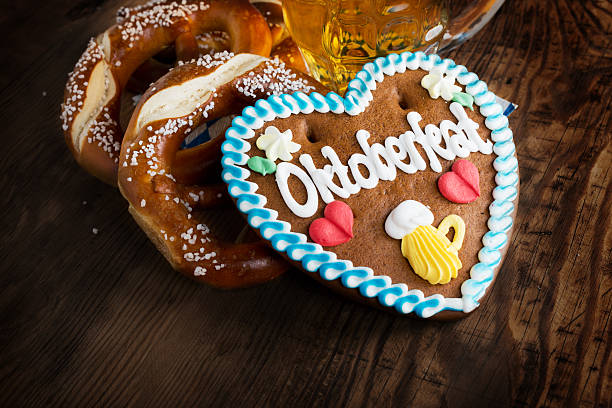 oktoberfest background – gingerbread heart with beer and pretzel - oktoberfest stock photos and pictures