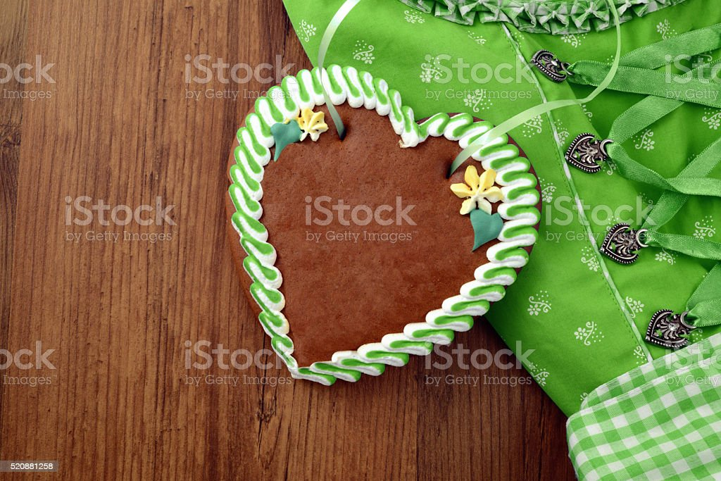 Oktoberfest background with Dirndl and copy space gingerbread heart stock photo