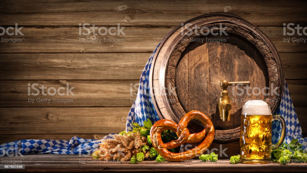 Oktoberfest beer barrel and beer glass stock photo