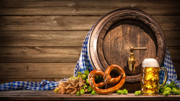 oktoberfest beer barrel and beer glass - oktoberfest stock photos and pictures