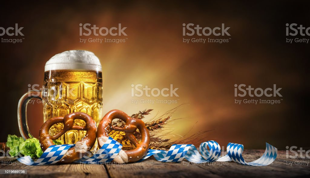 Oktoberfest beer with pretzel, wheat and hops stock photo