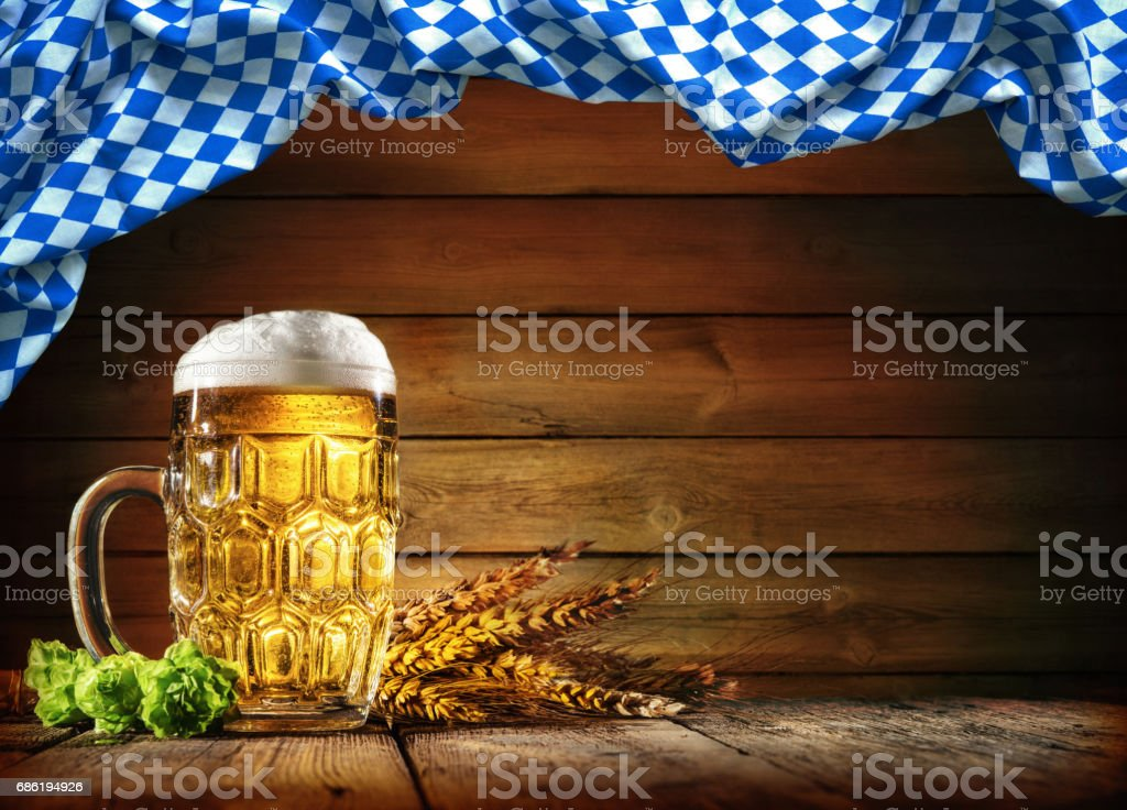 Oktoberfest beer with wheat  and hops stock photo