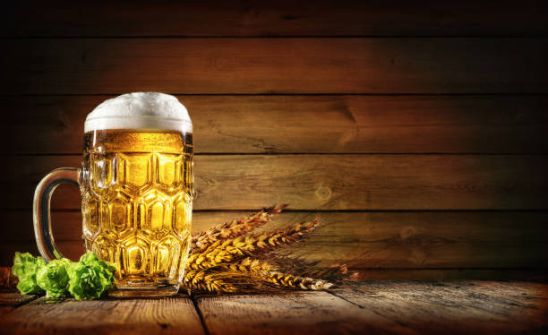 oktoberfest beer with wheat  and hops - german culture stock pictures, royalty-free photos & images