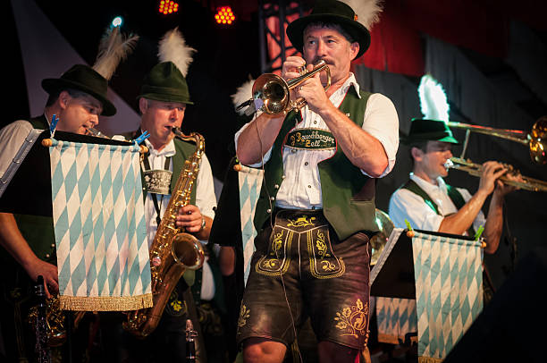 Oktoberfest - Brazil Blumenau, Santa Catarina, Brasil - October 12, 2011: Members from a traditional german band performing during the Oktoberfest. Each year the city of Blumenau in Santa Catarina state invites many bands from Germany to take part in the brazilian Oktoberfest. folk music stock pictures, royalty-free photos & images