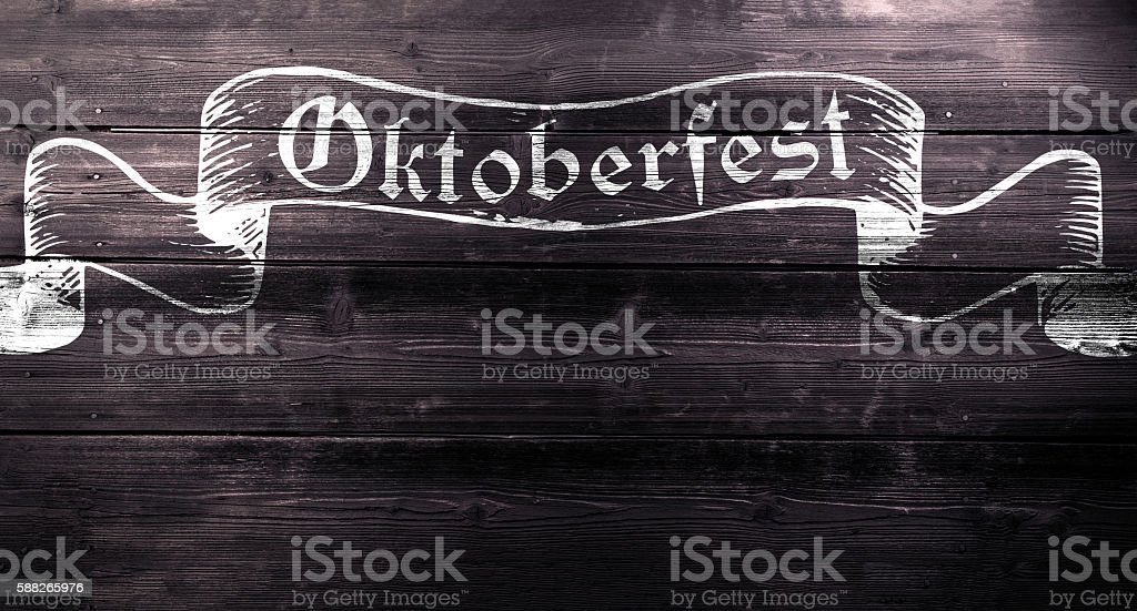 Oktoberfest chalk sign on textured wooden board, copy space stock photo