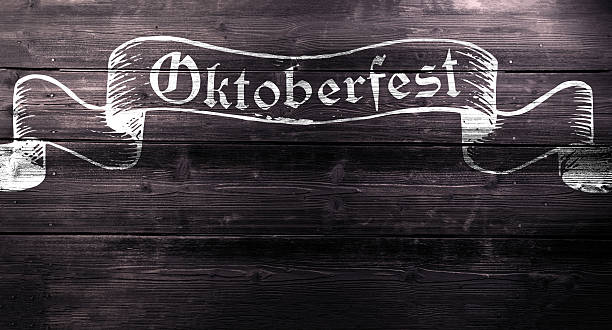 Oktoberfest chalk sign on textured wooden board, copy space - Photo