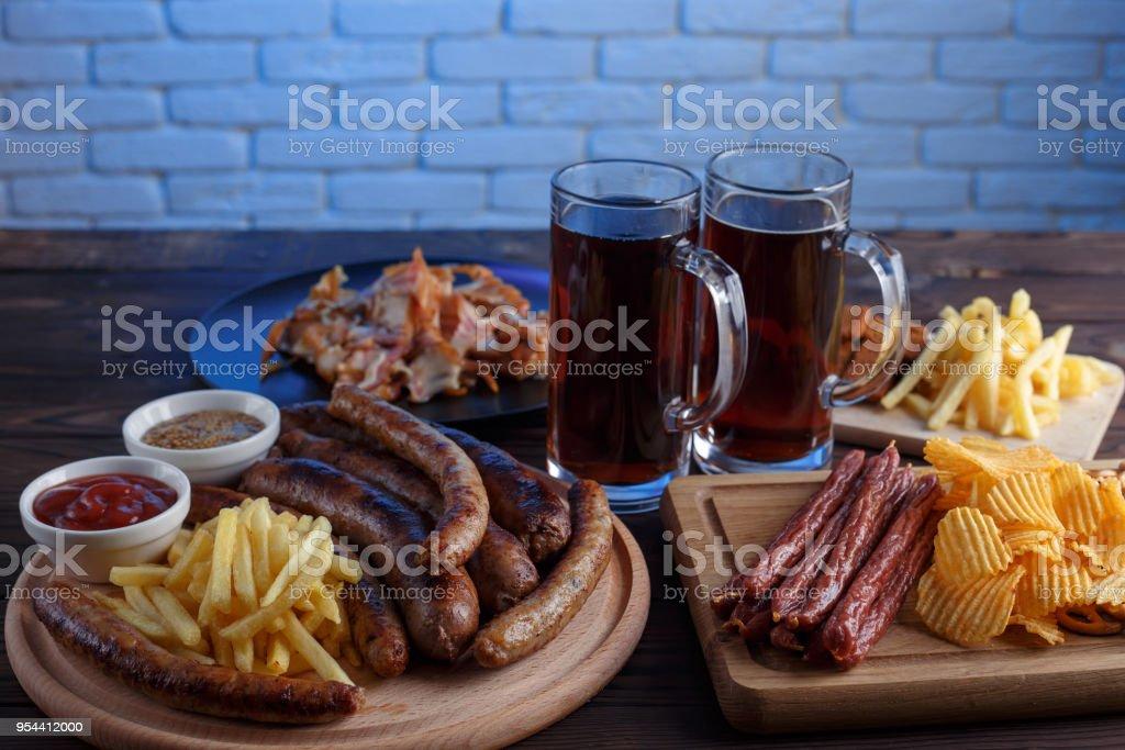 Oktoberfest food, appetizing beer snacks set for big company. Grilled...