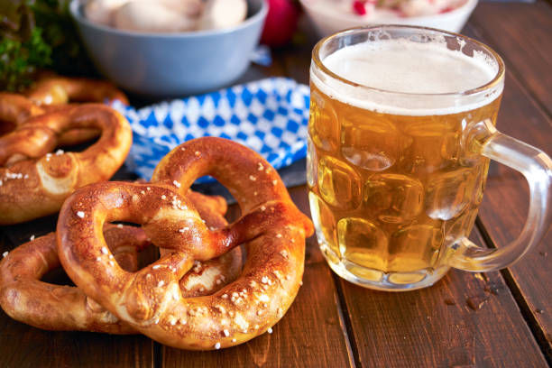 oktoberfest food on wooden table - oktoberfest stock photos and pictures