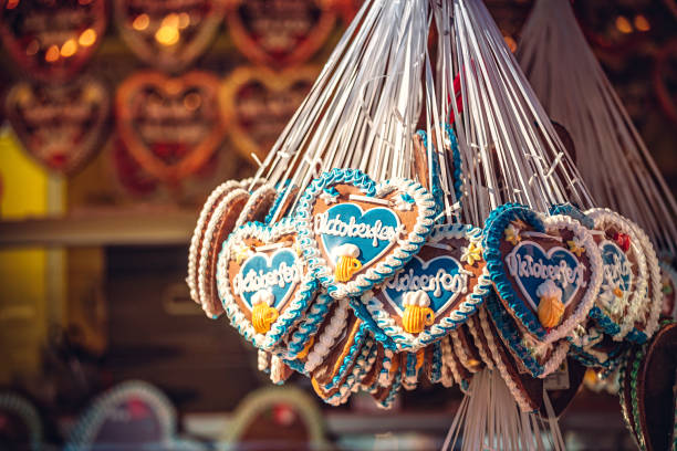 oktoberfest gingerbread hearts, munich, germany - oktoberfest stock photos and pictures