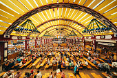 Munich, Germany - September 29, 2016: The Interior of Loewenbraeu brewery's festive tent at Oktoberfest in Munich, people having fun and drinking beer.