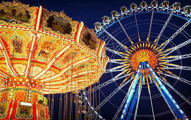 oktoberfest famous ferris wheel at the oktoberfest in munich - germany ferris wheel stock pictures, royalty-free photos & images