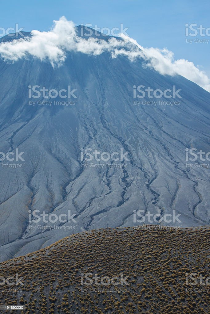Ol Doinyo Lengai Volcano Surrounded by Clouds stock photo