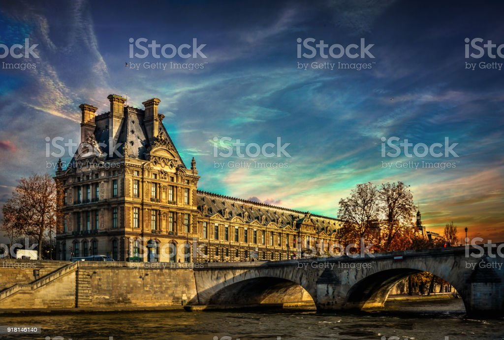 Ol Duilding near Seine River and beautiful colorful sunset stock photo