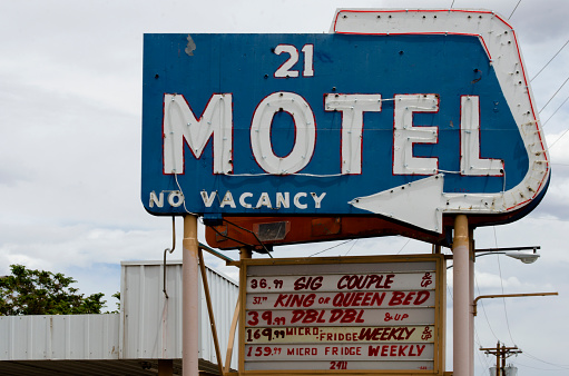 Albuquerque, United States - May 16, 2013: Old 21 Motel on Route 66 - The neon sign of a once fashionable motel, now looks a bit dilapidated.  Located along Route 66 in Albuquerque, New Mexico, many of these old motels have stories to tell of better days.