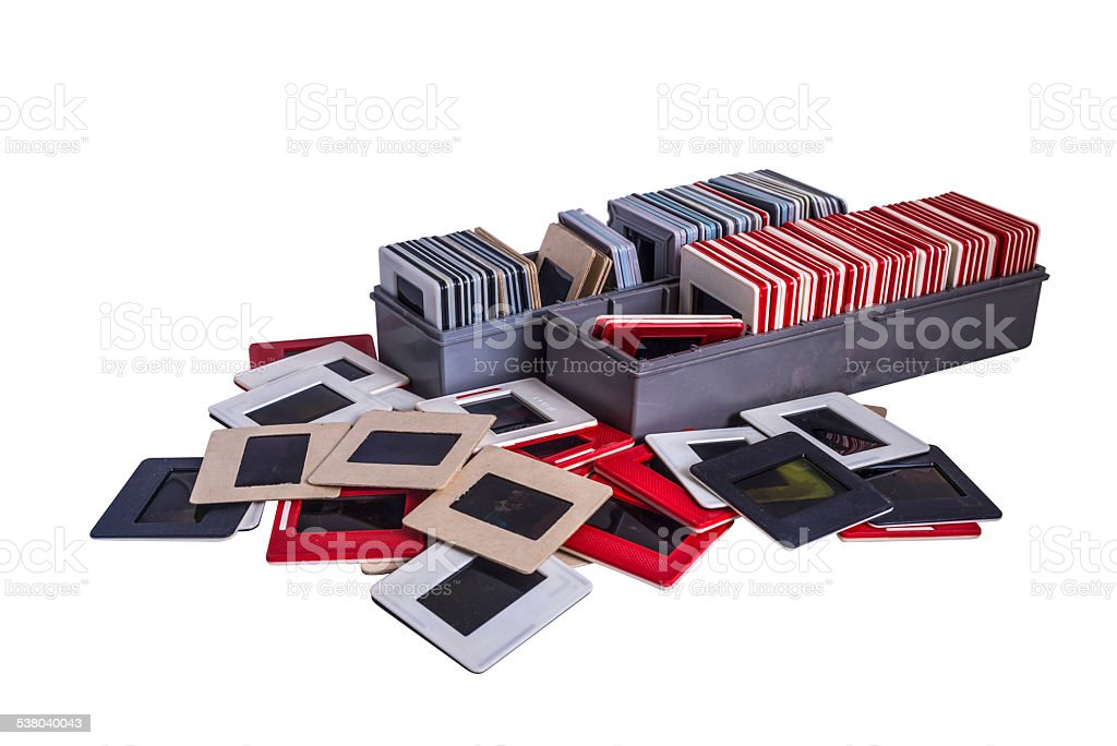 Old 35 mm mounted film slides and plastic boxes stock photo