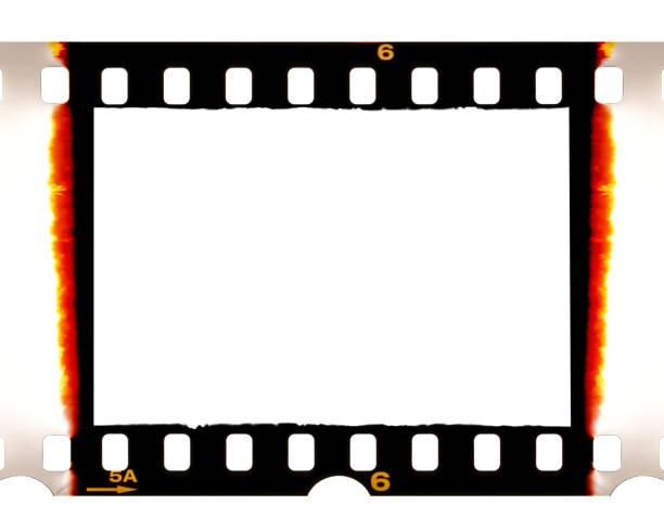 alten 35mm dia-film-frame mit gebrannten kanten auf weiß - spule stock-fotos und bilder