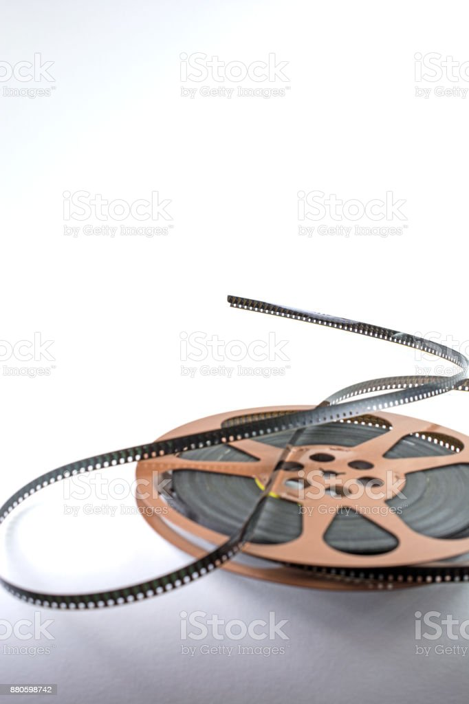 Old 8mm film on reel with shadows stock photo