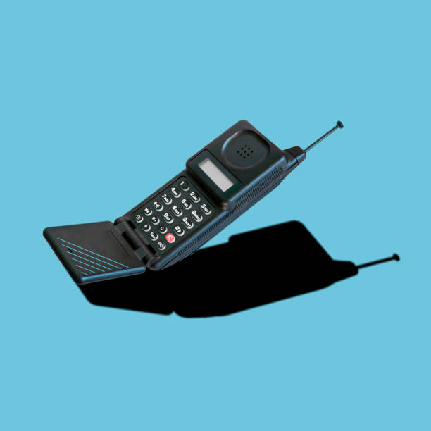 Old 90s classic analog mobile flip phone stock photo