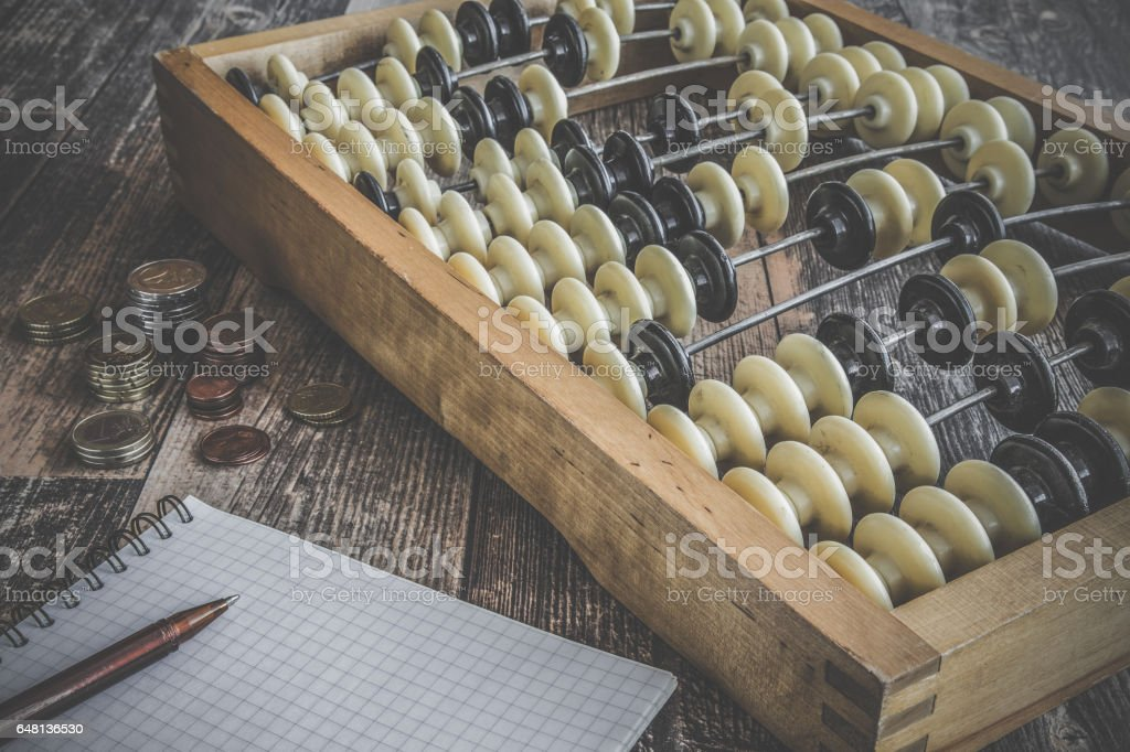 Old abacus on the wooden table. Retro things. stock photo