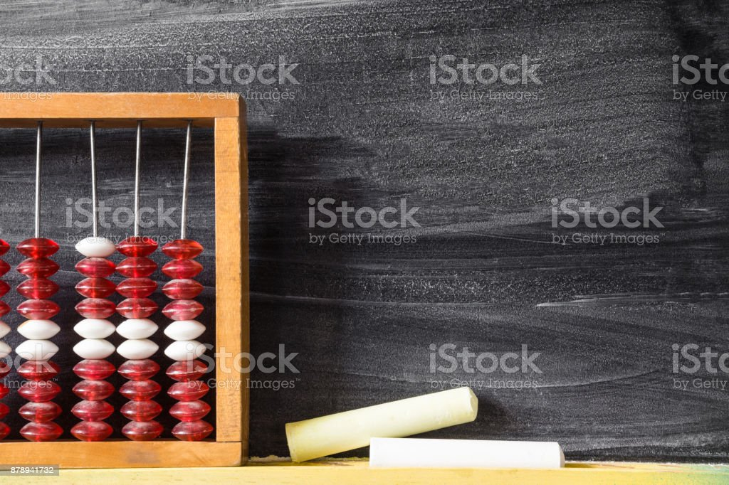 Old abacus with chalks at the blackboard in school. Mathematics lesson. Education concept. Empty place for a text. stock photo