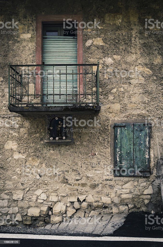old, abandoned and creepy windows on a stone wall royalty-free stock photo